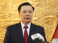 the minister of finance mr dinh tien dung restructuring public debts effectively