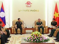 vietnam fosters defence links with laos us