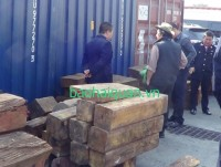3 containers transporting precious wood