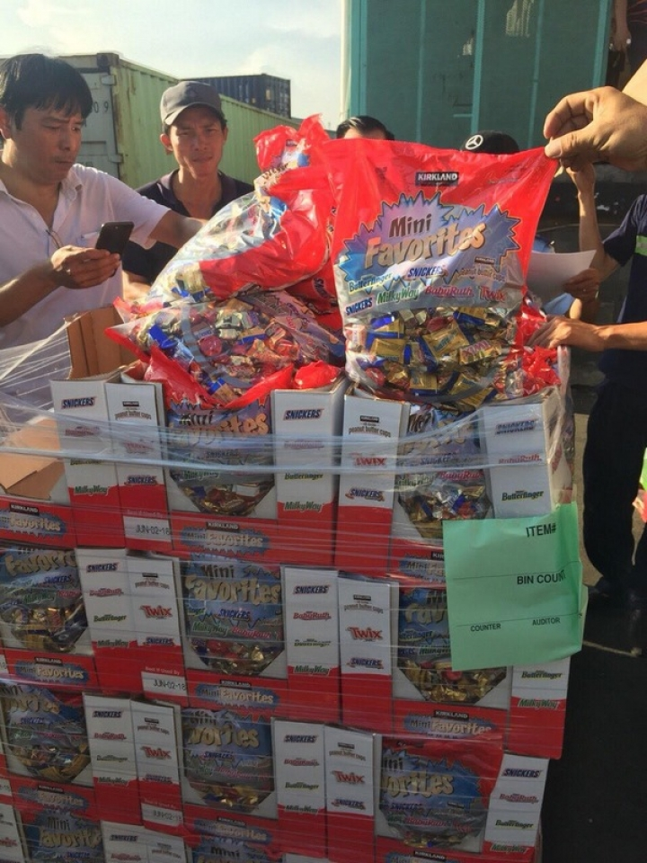 nearly 10 tons of smuggled cake and candy were seized at cat lai port