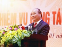 prime minister nguyen xuan phuc promoting the implementation of plan on tax modernization