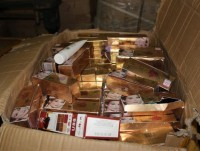2208 boxes of face powder and lip stick were hiden in an imported shipment