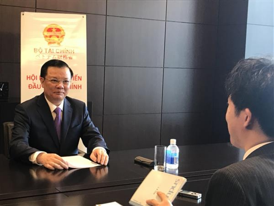 minister dinh tien dung committed to issue many policies to attract japanese investors