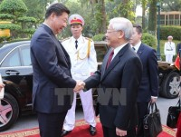 chinese press highlights vietnamese party chiefs visit
