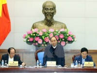 pm chairs viet nam laos co operation meeting