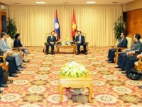 vietnam laos boost financial partnership
