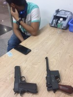 discovery of 2 hidden pistols in luggage of entry passenger