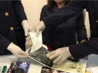 hidden cocaine inside luggage a female passenger is arrested at the airport